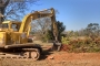Excavator Ready to Break Ground for Pool Installation