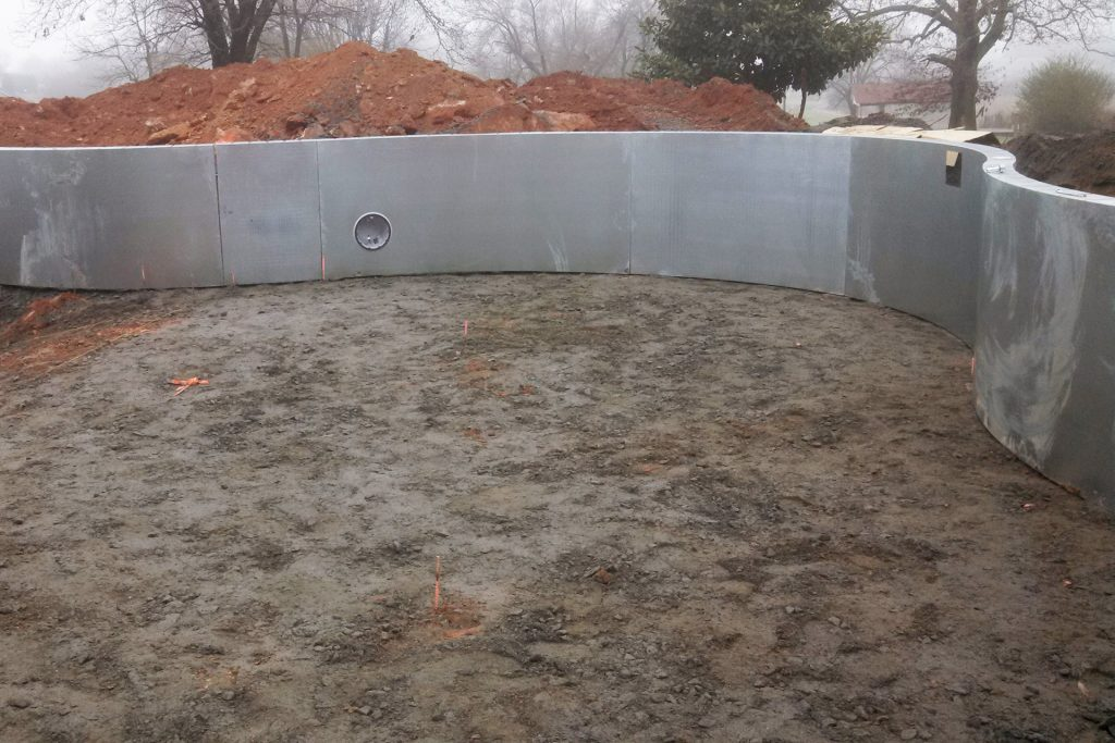 Steel pool walls during the installation process