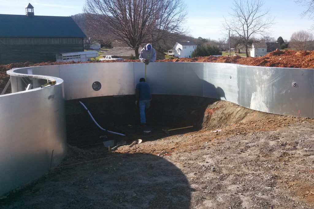 Measuring the deep end or an in-ground pool during construction