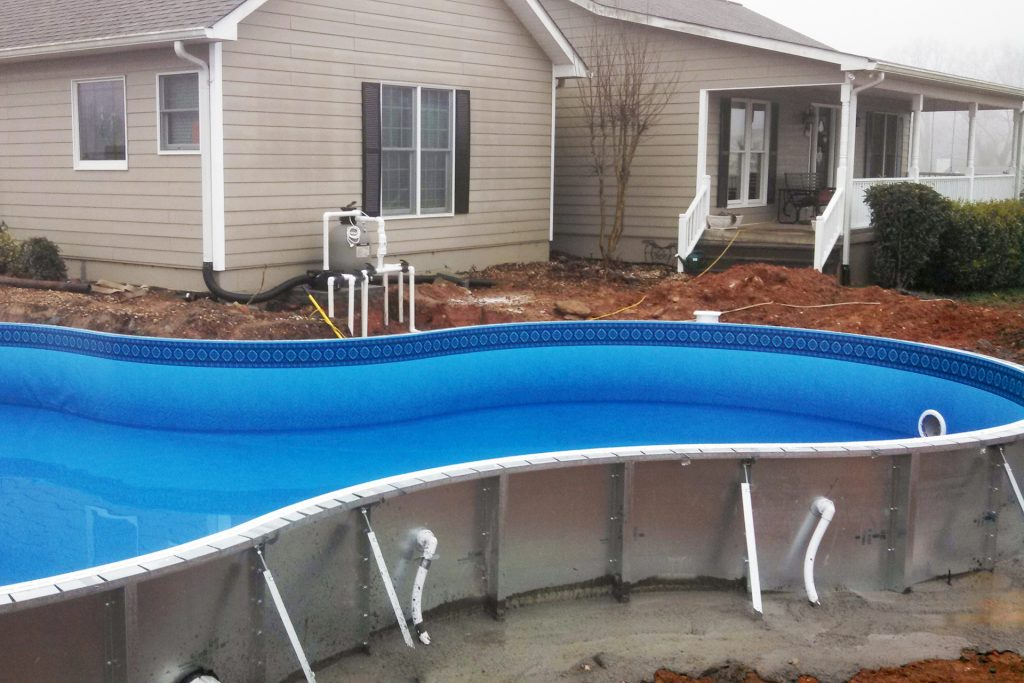 Newly installed swimming pool before backfilling