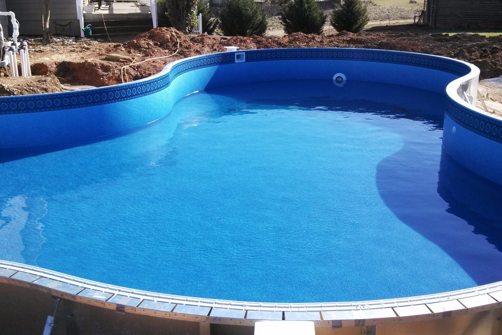Newly built swimming pool half filled with water